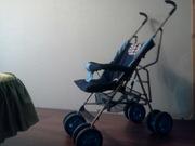 Прогулочная коляска «трость» ,